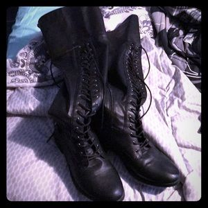 Torrid lace up knee high boots with back straps.